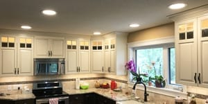 Image of a Kitchen Renovation with LED Potlights and Cabinet Lighting by exquisite electric