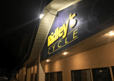 image of an LED exterior light installed by Exquisite Electric at Ridley's Cycle in Okotoks