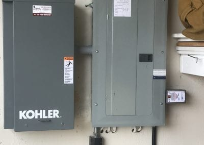 image of a kohler generator panel and an electrical panel with a surge protector