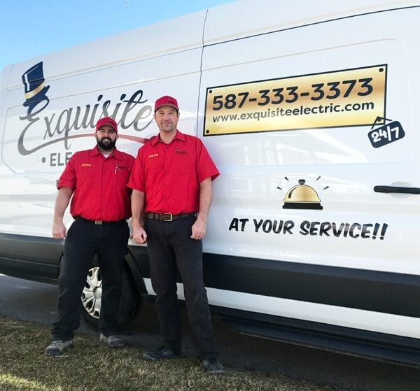 Image of Exquisite Electric Residential and Commercial Electricians Bryan and Dustin in front of an electrical service van