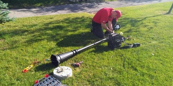 image of Commerial Electrician Dustin from exquisite electric fixing a lamp pole in High River